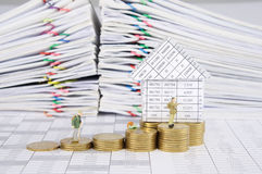 Close up traveler with step pile gold coins and house. Close up traveler with step pile of gold coins and house on finance account have blur pile overload Stock Photography
