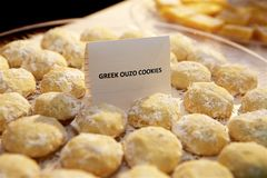 Greek Ouzo Cookies. Close-Up of a tray of round, sugared cookies. Foreground and background are blurred. Colors: yellow, white royalty free stock images