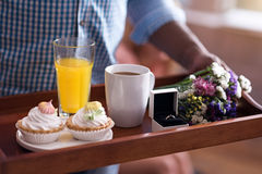 Close up of tray with wedding ring held by man Royalty Free Stock Photos