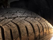 Close up of tread on tire. With dirt Royalty Free Stock Image