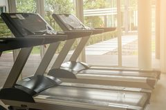 Close up the treadmill in gym room.Fitness Room with jogging treadmill and exercise machine. Exercise class royalty free stock photo