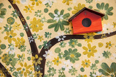 Close up tree art painting and bird house on cement.  royalty free stock photography