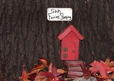 Whimsical Red Fairy Door In A Tree Trunk Stock Image - Image
