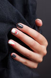 Close-up of trendy spotted nails Royalty Free Stock Images