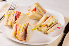 Close Up of Triple Decker Sandwich on Plate Stock Image