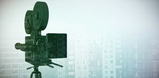 Composite image of close-up of tripod with film reel camera Royalty Free Stock Photos