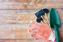 Close up of trowel, nameplates and garden gloves Royalty Free Stock Image