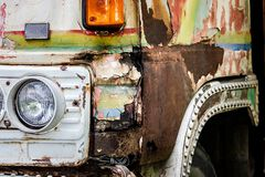 Old truck with rusty. Close up of truck rusty, damaged, and flat tires stock image