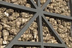 Pile sugar beets behind grid iron fence of truck or barn royalty free stock image