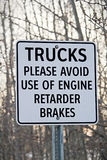 Close Up of Trucks Avoid Retard Brakes Sign Stock Photo