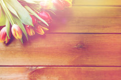 Close up of tulip flowers on wooden table Royalty Free Stock Photos