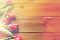 Close up of tulip flowers on wooden table Royalty Free Stock Image