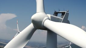Close up of the turbine of a windmill against the blue sky stock video footage