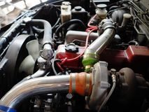 Close up turbo charger on car engine. Detail of car under hood royalty free stock photo