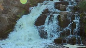 Close-up of turbulent waterfall, stream running down the slope. Stock footage stock video footage