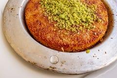 Turkish Künefe, Hot and Cheesy Southeastern Dessert. Close up Turkish Künefe, Hot and Cheesy Southeastern Dessert stock photography