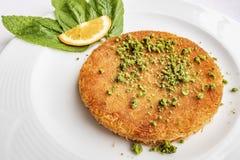 Turkish Künefe, Hot and Cheesy Southeastern Dessert. Close up Turkish Künefe, Hot and Cheesy Southeastern Dessert stock image