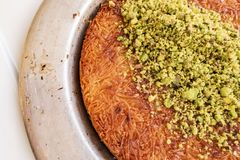Turkish Künefe, Hot and Cheesy Southeastern Dessert. Close up Turkish Künefe, Hot and Cheesy Southeastern Dessert royalty free stock photos