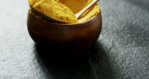 Turmeric powder in bowl 4k. Close-up of turmeric powder in bowl 4k stock footage