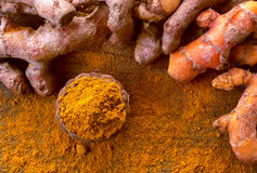 Close up turmeric powder on grunge wooden background. Stock Photos