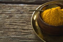 Turmeric powder in plate Stock Photography