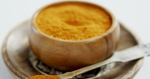 Turmeric powder in plate 4k. Close-up of turmeric powder in plate 4k stock footage