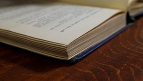Close up of turning book pages. Reading of old book stock footage