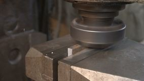 Processing of metal piece with lathe machine. Close-up of turning machine rotating and putting into shape piece of metal stock video