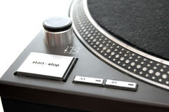Close up of Turntable. A close up of a DJ turntable isolated on white. Start/stop button Stock Photo