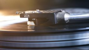 Close up of the turntable cartridge and the vinyl record. 4K stock video footage