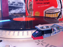 Close up of turntable needle with jazz albums in the background Stock Photos
