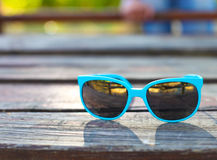 Close up of a turquoise glasses Royalty Free Stock Image