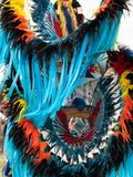 Close Up of Turquoise Ribbons on Quill and Feather Bustle and Headdress at a Pow Wow. Close up of turquoise ribbons streaming from feather and quill headdress royalty free stock photography
