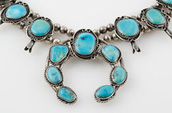 Close Up of Turquoise Squash Blossom Necklace. Stock Photo