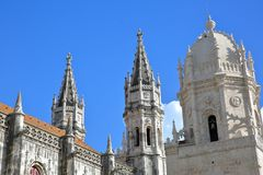 Close-up on the turrets and spires of Jeronimos Monastery in Belem neighborhood, Lisbon, Portugal. Close-up on the turrets and spires of Jeronimos Monastery in Royalty Free Stock Photo