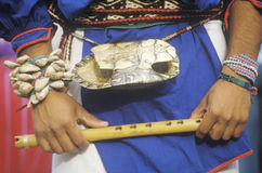 Close-up of turtle shell worn on the waist of a man holding flute during Corn Dance ceremony  in Santa Clara Pueblo, NM Royalty Free Stock Image
