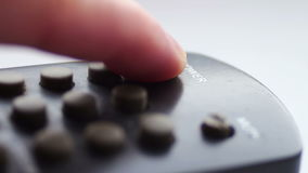 Close up Of TV Remote. TV remote control, the finger presses the button to turn on, close up view stock video