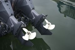 Close Up Of Twin Outboard Motors Propellers. stock photo