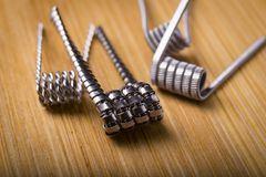 Close up twisted coils for e cig or electronic cigarette for vap Royalty Free Stock Image