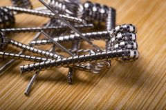 Close up twisted coils for e cig or electronic cigarette for vap Stock Photos