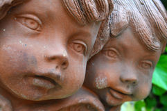 Close up of two antique clay angel figurines Royalty Free Stock Photos
