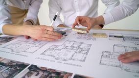 Close Up Of two Architects Discussing Plan Together At Desk With Blueprints. 4 k stock footage