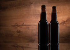 Close up of two beer bottles Stock Photos