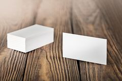 Close Up of two blank horizontal business cards at wooden background. Close Up of two blank horizontal business cards at the wooden background Royalty Free Stock Image