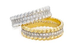 Close-up on two bracelets made of a gold and a silver with diamo Royalty Free Stock Images