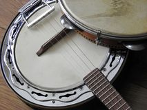Close-up of two Brazilian musical instruments: samba banjo and pandeiro tambourine. royalty free stock photos