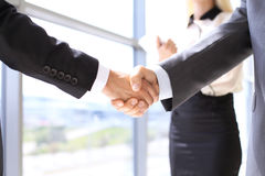 Close up of two business man shaking hands to each other finishing up the meeting stock image