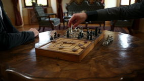 Close up of a two business men playing chess and shaking hands after a game. HD1080p: Close up of a two business men playing chess and shaking hands after a game stock footage