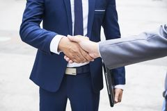 Business handshake outdoors stock photography