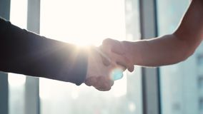 Close-up of two business partners shaking hands to signify an agreement
